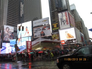 "See the red ""Tkts"" sign near the traffic light? That's where you can get last minute deals to the Broadway theatre ;)"
