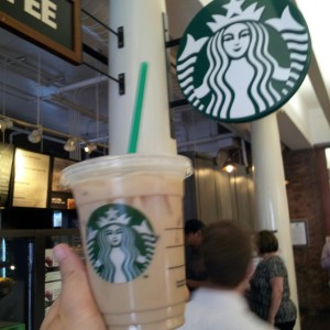 Taking a shot of my Iced Tazo Tea Chai Latte (US$3.15) in front of Starbucks :)