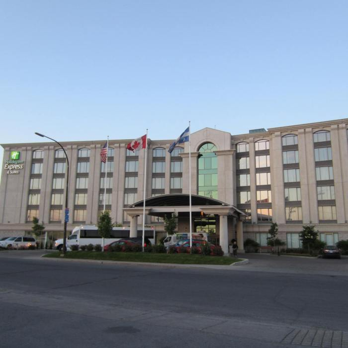 Front view of the hotel with Montreal flag on the right