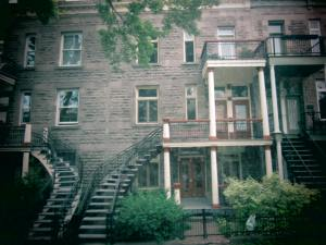 See the long spiral staircase outside leading directly to the second floor of the house?