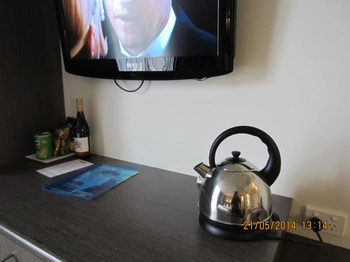 The cool kettle on the cabinet top with snacks & wine on the left