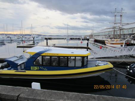 The Pennicott Wilderness Journey's yellow boat by the waterfront