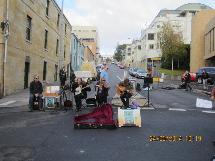 Buskers performing in the middle of the market