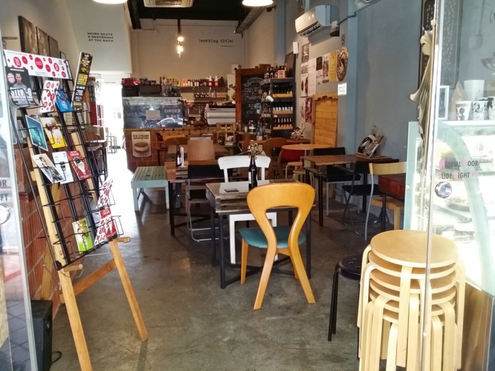 Working Title - a humble cafe with electic mix of tables and chairs