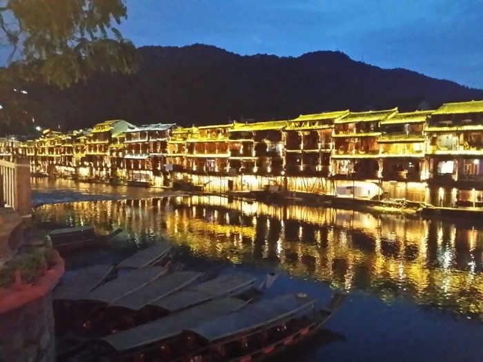 Stunning night view of the unique houses on stilts by the river (土家吊脚楼)