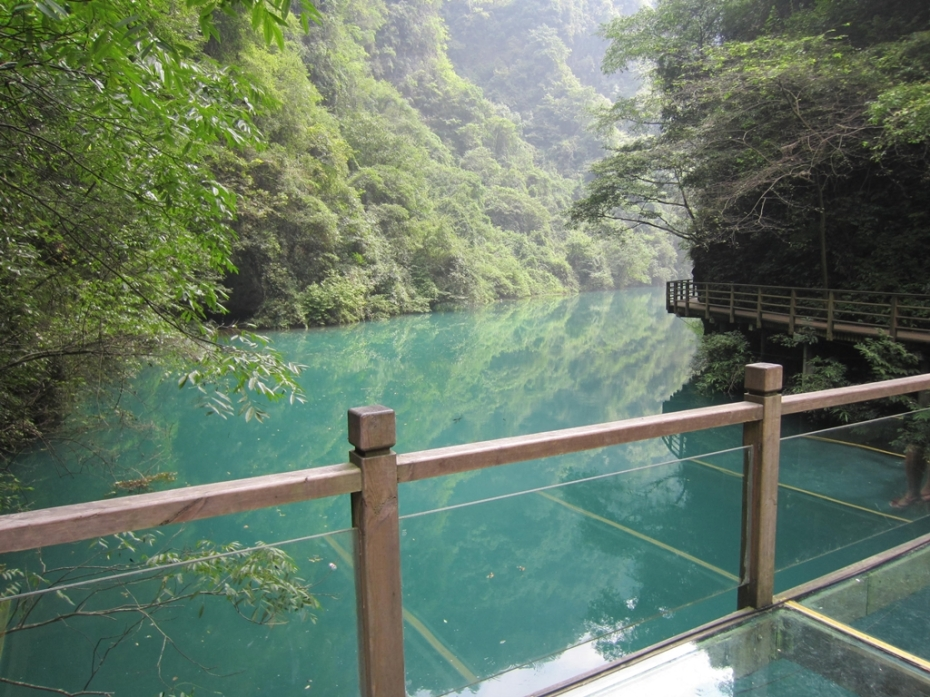 Beautiful emerald crystal clear lake with a miniature glass walk here