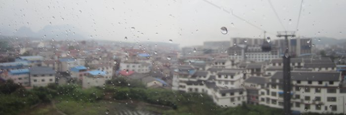 View of a rainy Zhangjiajie city on the cable car