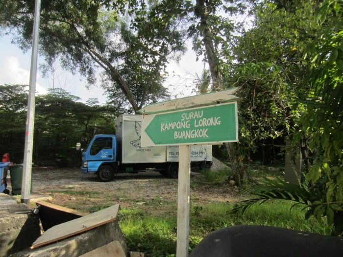 Signage at kampong entrance looks so proper these days compared to the handwritten sign in the past!