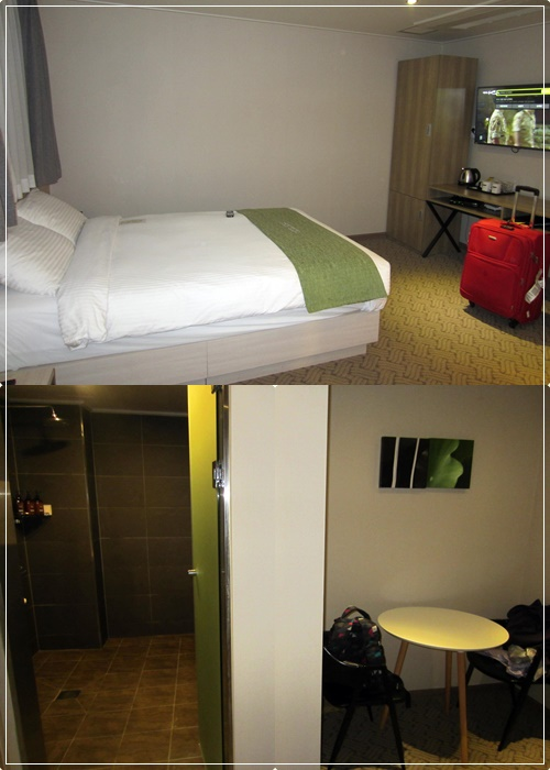 Comfortable double bed with a large flat-screen smart TV, spacious bathroom & even a work corner