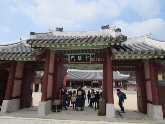 Lanky guards surrounded by elementary students at Jungyangmun